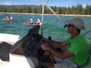 Steve Bannar, co-medical director for Primal Quest and orthopedic surgeon at Tahoe Center for Orthopedics keeps an eye on racers as they kayak on Lake Tahoe.