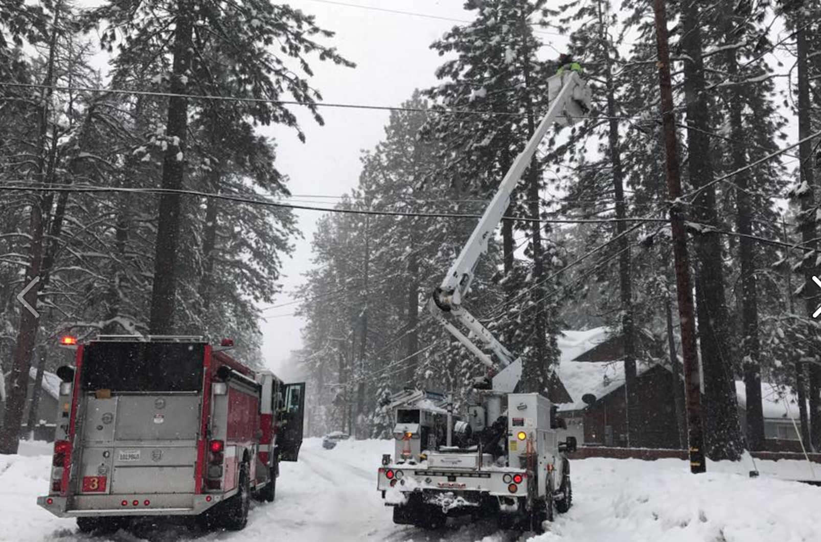 South Tahoe fire and Liberty Utilities crews work on downed power lines. Photo/Provided