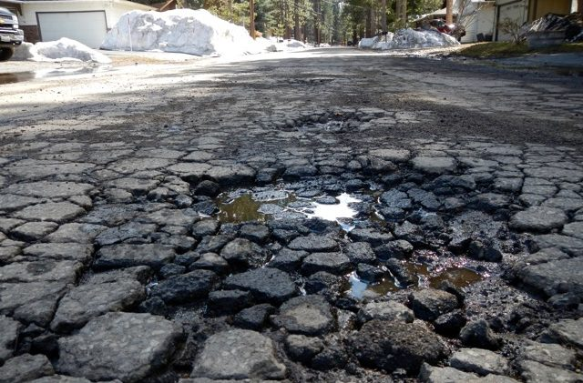 Brown signs mega-tax to fix Calif. roads, bridges