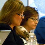 DCSC board members Cindy Trigg, left, and Teri Jamin listen during the budget session.