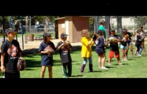 Coach Phil helps kids learn softball skills during the popular Jr. Giants program at the club last summer. Photo/Provided