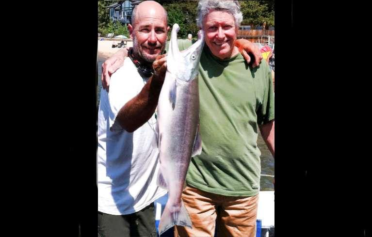 Capt. Scott Carey and fisherman Bill Brush with the record-breaking Kokanee. Photo/Tahoe Sport Fishing