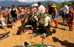 U.S. Forest Service officers on July 4 hold down a man who was in a fight. Photo/Julie Gardner