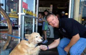 Truckee Police Officer Jeff Safford with his friendly assistant Bear who helped greet customers at the Wagon Train. Photo/Provided