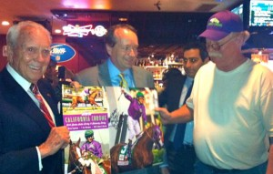 Steve Coburn, right, with Joe Asher, CEO of William Hil Sportbook and l, sharkey's owner Harold holder; by susan wood