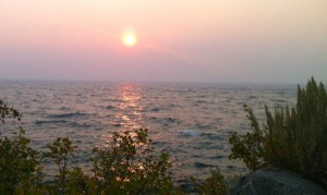 Smoke from the King Fire makes for a colorful sunset at Cave Rock. Photo/Susan Wood