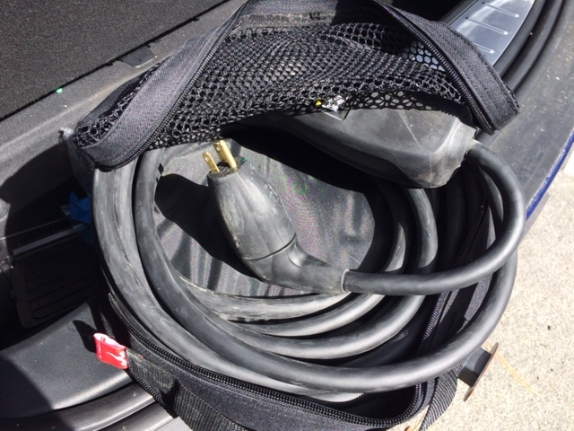 "Charging ""adapter"" cord, used only when not hooked up to a Tesla free charging station. Photo/Carole Bernardi"