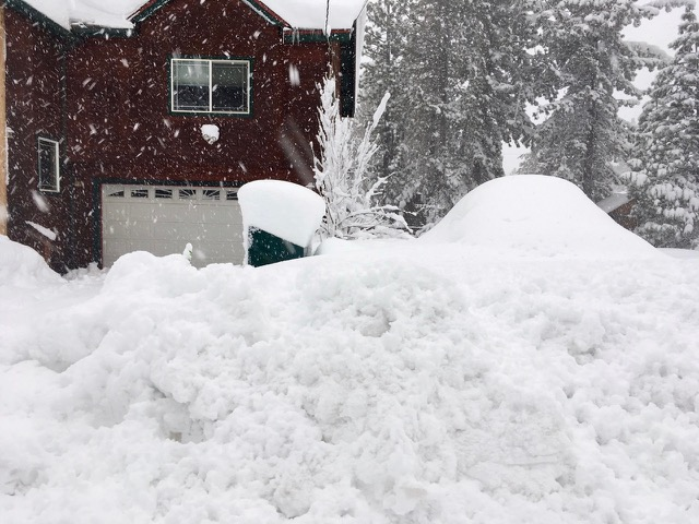 Berms several feet high are being left on streets in Meyers. Photo/Kim Wyatt